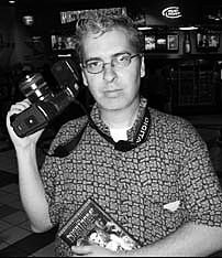 Tampa Bay entertainment and business polymath C. A. Passinault, AKA DJ Frontier, posing here as a photographer and a writer covering a Tampa Bay indie film festival in October 2007. Photograph by Andy Lalino.